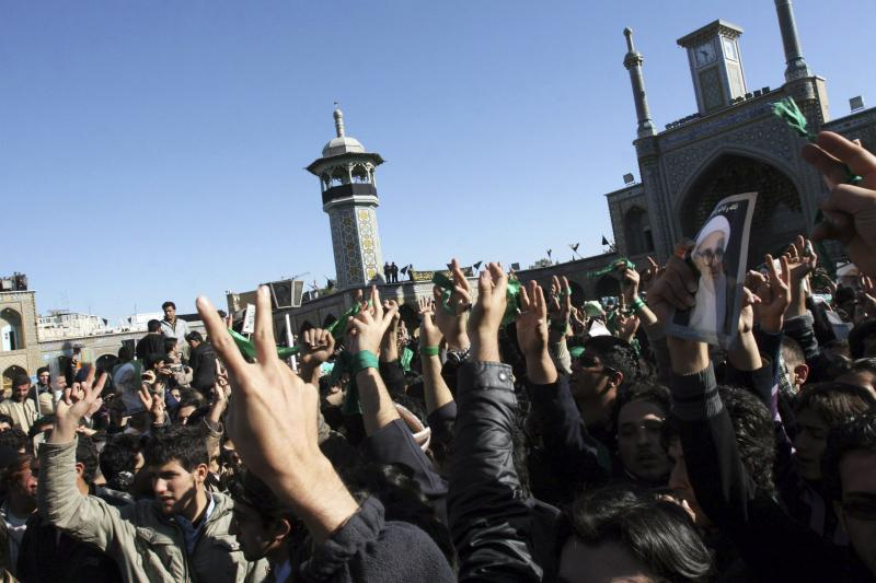 Supporters of the Iranian opposition movement wear green in the holy city of Qom, December 2009.