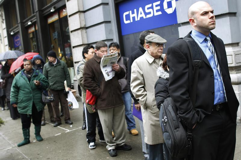 People wait in line to enter the NYCHires Job Fair in New York, February, 2010.