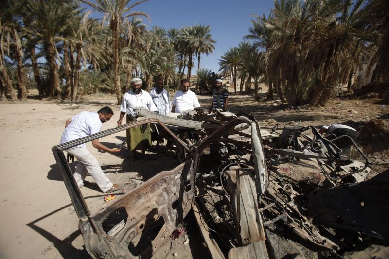 People and human rights activists examine the site of a U.S. drone strike that targeted suspected al Qaeda militants in August 2012, in the southeastern Yemeni province of Hadhramout, February 2013.