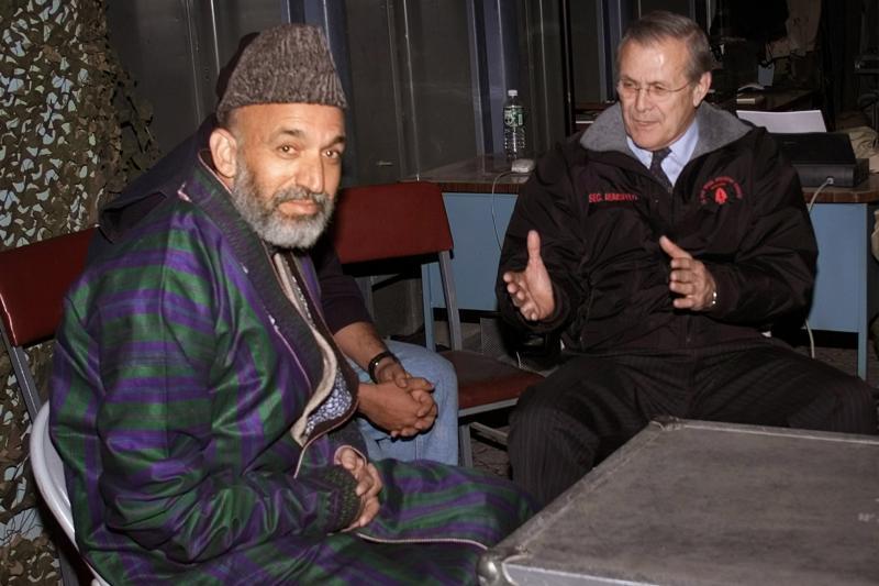 Hamid Karzai with U.S. Defense Secretary Donald Rumsfeld, Bagram Airfield, Afghanistan, December 2001.