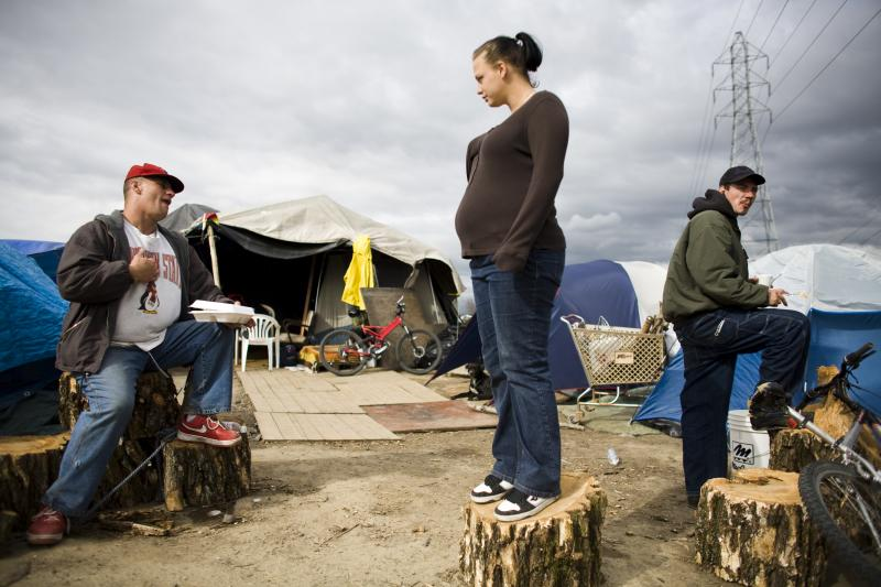In a tent city, outside Sacramento, CA, March 2009.