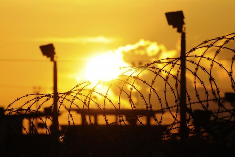 "The sun rises over the U.S. detention center ""Camp Delta"" at Guantanamo Bay, Cuba, October 2012."