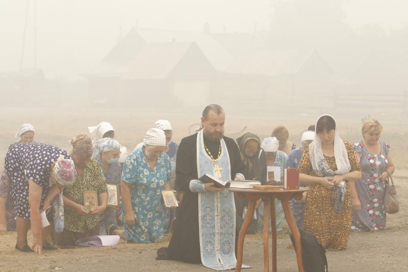 People pray for rain in the Russian village of Kriusha, August 2010.
