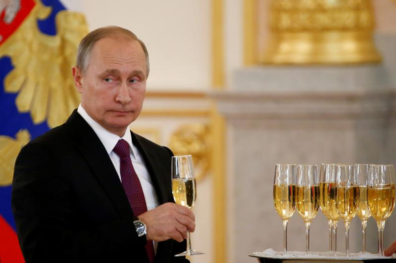 Russian President Vladimir Putin sips champagne at a diplomatic function in Moscow, November 2016.