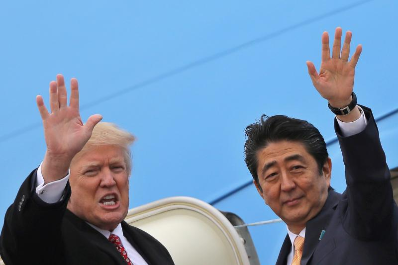 U.S. President Donald Trump and Japanese Prime Minister Shinzo Abe board Air Force One in Maryland, United States, February 2017.