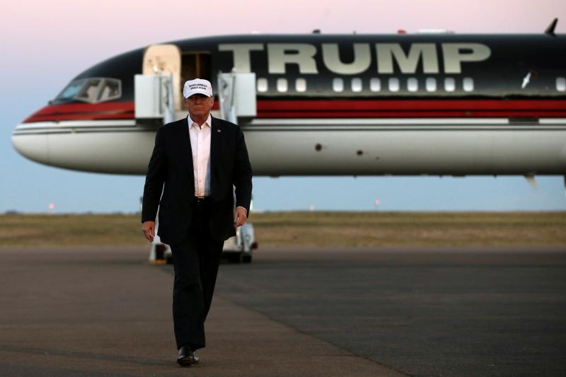 Trump walks off his plane at a campaign rally in Colorado Springs, Colorado, September 2016.