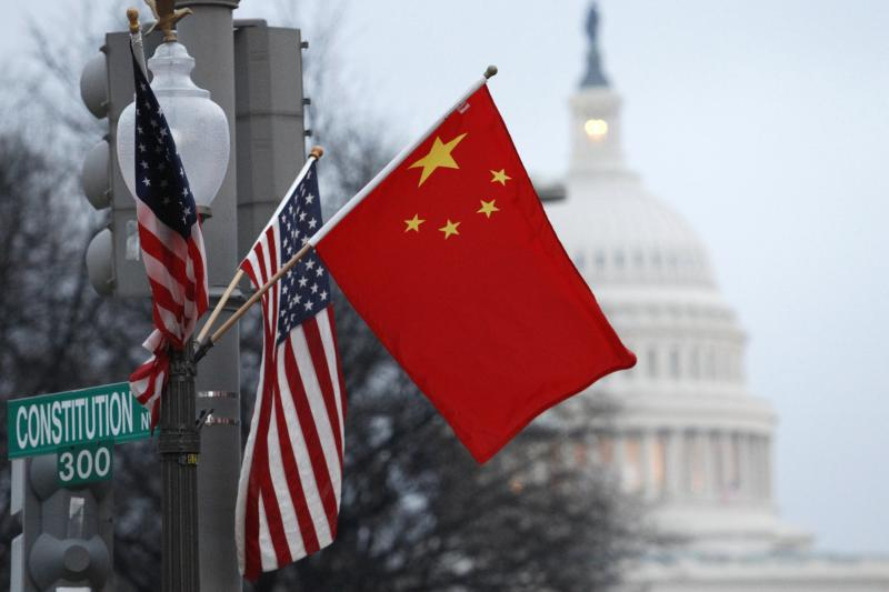 Chinese and U.S. flags fly on a lampost in Washington D.C., during Chinese President Hu Jintao's visit, January 2011