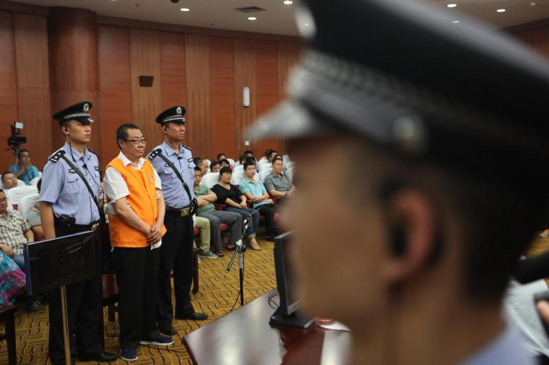 Yang Dacai, a former Chinese provincial official, listening to a verdict on charges of corruption in Xi'an, China, September 2013.