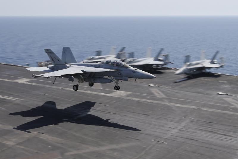 A F/A-18E/F Super Hornet landing on an U.S. aircraft carrier in Bahrain, June 2015