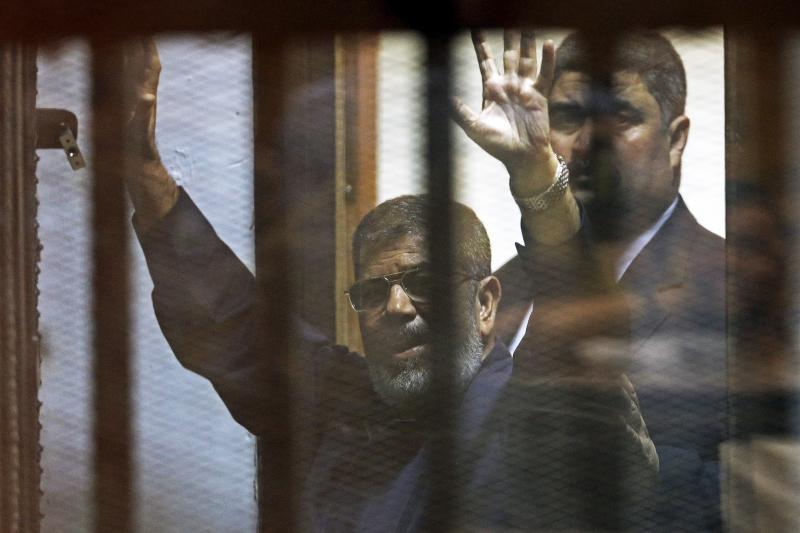 Deposed Egyptian President Mohamed Mursi behind bars at a court on the outskirts of Cairo, Egypt in June 2015