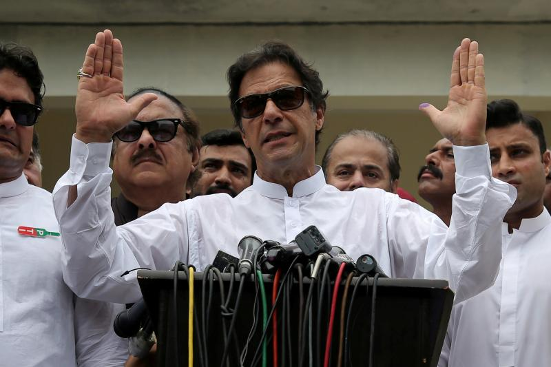 Prime Minister of Pakistan Imran Khan speaks to members of the media after casting his vote during the general election in Islamabad, Pakistan, July 2018