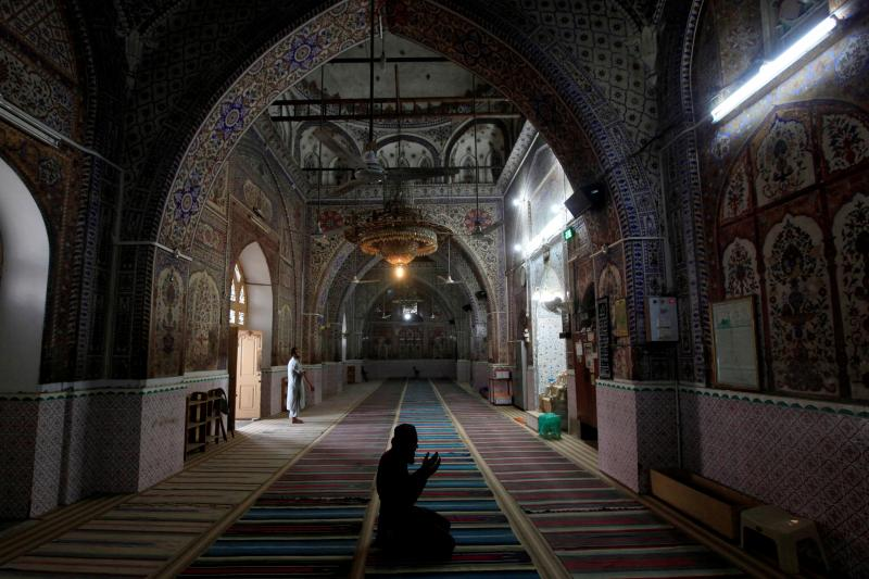 A man offers afternoon prayers at a mosque in Rawalpindi, Pakistan, August 2017