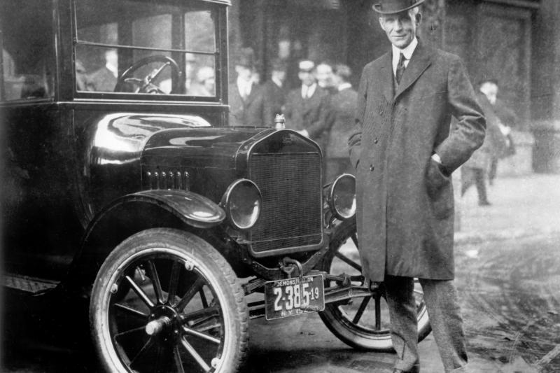 Henry Ford next to a 1921 Model-T.