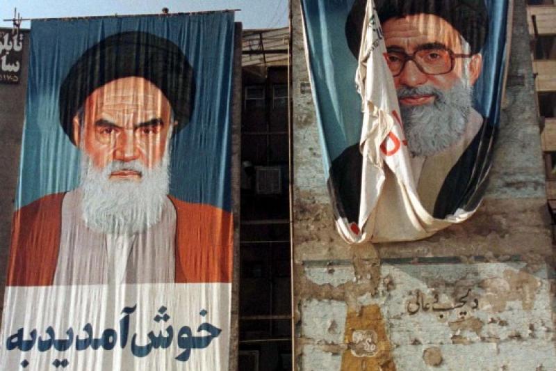Teacher and student: portraits of Iran's supreme leaders, Tehran, November 1997.
