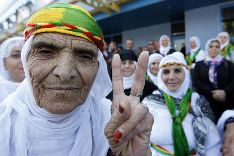 A Kurdish woman making a victory sign in Turkey, December 2009.