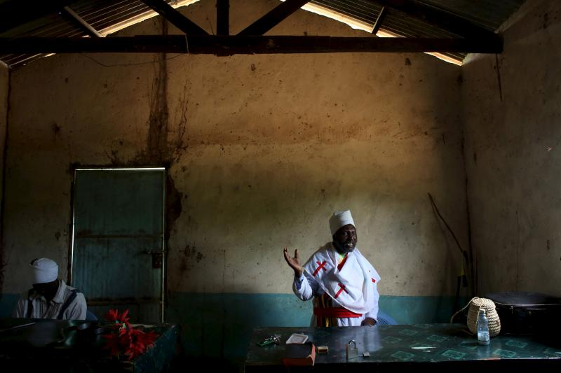 A pastor prays during an Easter Sunday service in a church in Garissa, April 5, 2015.