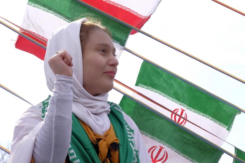 An Iranian woman chants slogans during a ceremony marking the 37th anniversary of the Islamic Revolution, in Tehran, February 11, 2016.