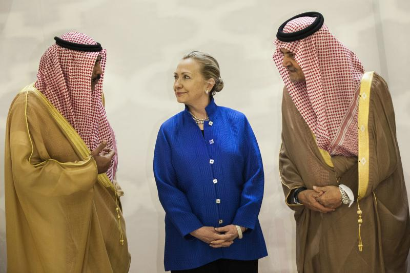 Saudi Arabia's Foreign Minister Saud al-Faisal, U.S. Secretary of State Hillary Clinton and Kuwait's Foreign Minister Sheikh Sabah Khalid Al-Hamad Al-Sabah chat before a group photo ahead of a U.S.-Gulf Cooperation Council forum