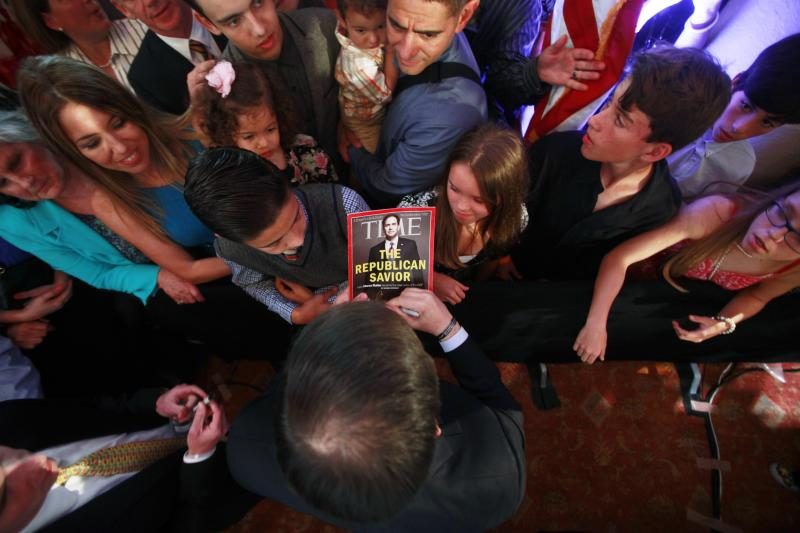 Rubio autographs a magazine with his picture on the cover in Miami, Florida, April 13, 2015.