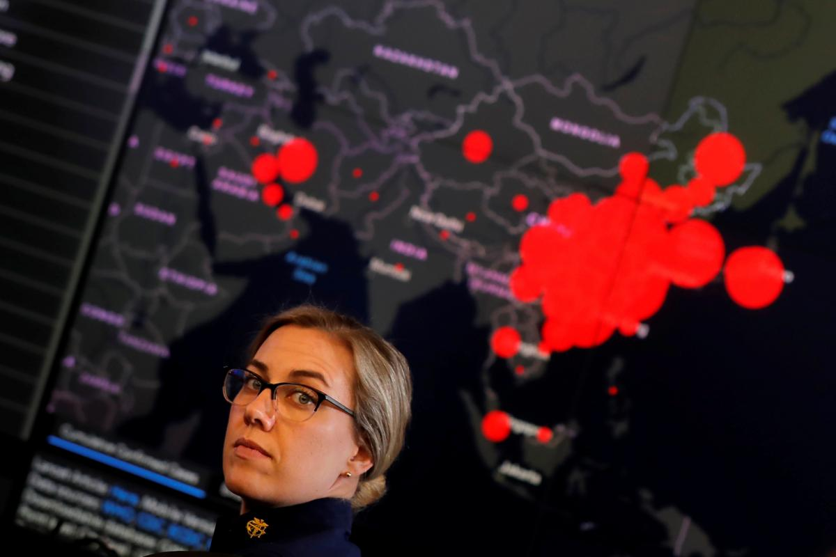 A Health and Human Services staff member shows a coronavirus outbreak map in Washington, D.C., February 2020 Carlos Barria / Reuters